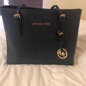 Michael Kors navy blue handbag